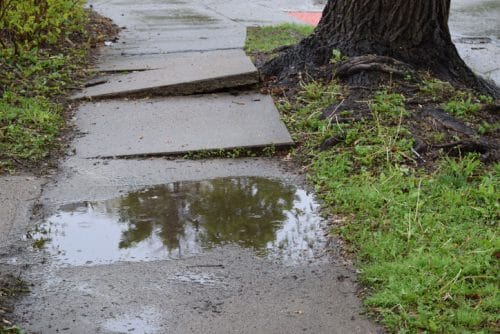 Who is Liable if You Are Injured by a Slip and Fall on an Uneven Sidewalk?